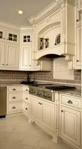 antique white kitchen cabinets with subway tile backsplash light cabinets light floor backsplash walls