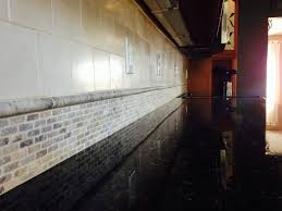 corner view of the custom tuscany classic backsplash using subway