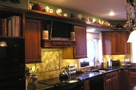 should i decorate on top of my kitchen cabinets how can i decorate the tops of my kitchen cabinets kitchn