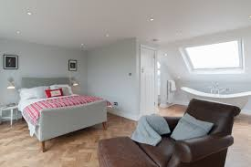 50 degrees north architects dormer loft conversion project in giant attic bedroom with bath tub