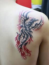 red and black tribal flying phoenix tattoo on back shoulder
