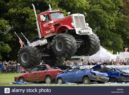 monster trucks shows monster trucks crushing old cars at a farm show gloucestershire