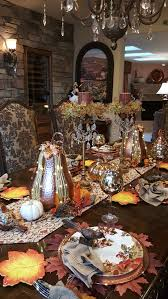 a thanksgiving table with gourds and birds and