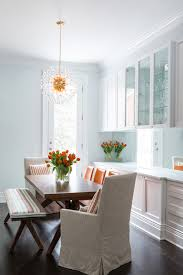 blue dining room with orange accents transitional dining room