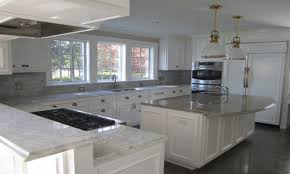 granite countertop different colored kitchen cabinets backsplash