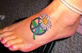 small peace symbol tattoo on foot