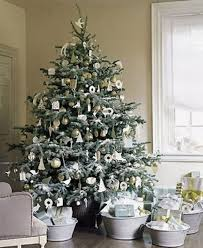 silver and white color decorated tree decorating