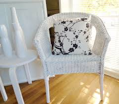 white wicker chair with handmade cherry blossom cushion white