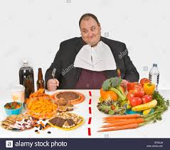 table full of food overweight man sitting at a table full of food stock photo 78072029
