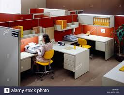 1980s Furniture 1980s Open Space Office With Woman Typing Stock Photo 25958572 Alamy