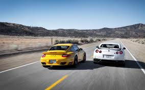 black porsche 911 turbo 2013 nissan gt r black edition vs 2012 porsche 911 turbo s