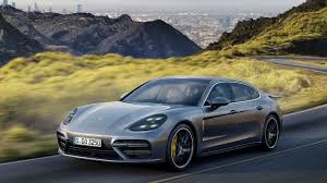 porsche 4 door sports car porsche adds two hybrids to its panamera line la times