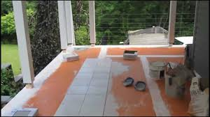 Tiling A Concrete Patio by How To Install Tile On Screened In Two Season Room Deck Youtube