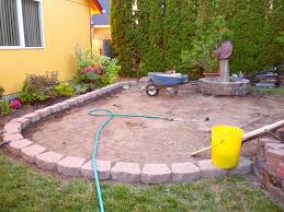 do it yourself paver patio here u0027s a raised curved paver patio with a fire pit patio ideas