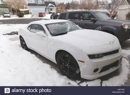 maserati driveway white sports car parked in snowy driveway on a cold winter day