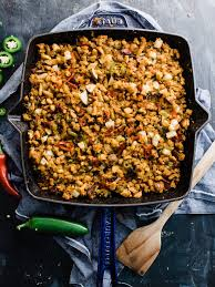 spicy bacon jalapeno cornbread with a pan
