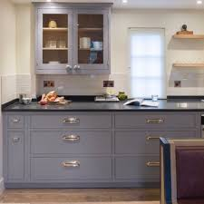grey kitchen units with black granite worktops a bespoke in frame kitchen with grey cabinetry chrome cup