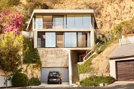 hillside house plans for sloping lots a daring concrete home rises on and in a los angeles cliff curbed