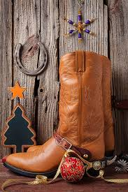 cowboy boots and ornaments photograph by garry