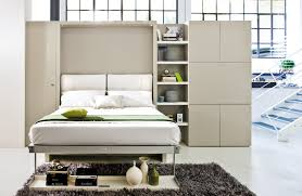 bedroom wooden bed books wall frame small space bedroom designs