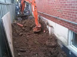 backyard exterior block foundation waterproofing cinderblock