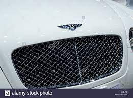 bentley logo bentley logo and grill on a white bentley car stock photo royalty