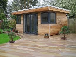 a beautifully clad garden room in western red cedar built by