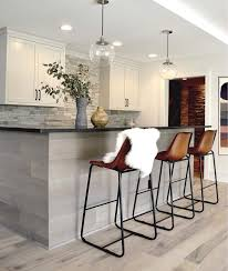 gray oak kitchen island with leather counter stools transitional