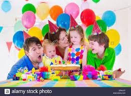 happy family celebrating birthday parents and three children