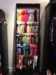 great way to organize scarves and belts build a ladder to display
