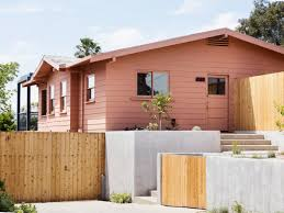 productora adds steel frame extension to pink bungalow in los