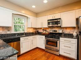 kitchen with limestone tile u0026 undermount sink in springfield va