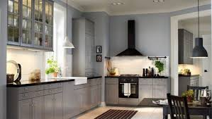 Simple Kitchen Makeovers - black hood and contemporary grey cabinet for affordable kitchen