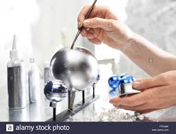 painting christmas balls manufacturing and crafts woman decorate