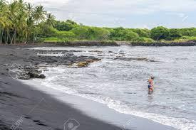 black sand beach big island woman snorkeling in punalu u black sand beach big island hawaii