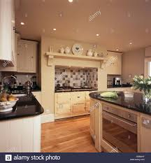 cream aga oven in country kitchen with built in oven in island