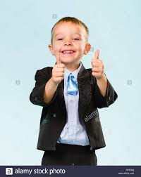 boys light blue suit smiling little boy wearing suit thumbs up studio shot and light