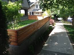concrete retaining wall w modern wood trellis landscaping ideas