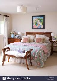 Wooden Headboards For Double Beds by Wooden Bench Seat At Foot Of Double Bed With Wooden Headboard And