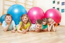 five happy lie in with large balls stock photo picture