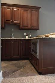 what color paint goes with brown kitchen cabinets pin by jodee haase on kitchen ideas brown cabinets
