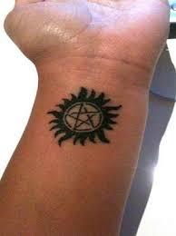 pentagram and sun on wrist