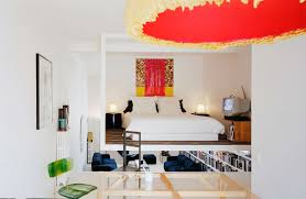 how to apply contemporary interior design in your home midcityeast captivating bedroom with large bed between table lamp also painting