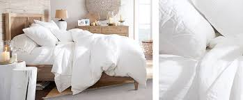 how to layer a bed how to style your bed pottery barn