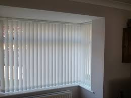modern vertical blinds in white for window with vinyl material