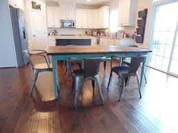 hand made reclaimed wood farmhouse table with beautiful turquoise