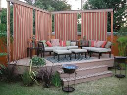 corner backyard deck with privacy screen curtains adding a