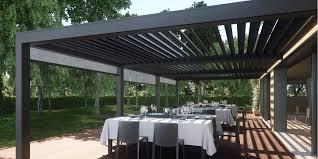 tettoia autoportante pergola bioclimatica opera addossata a parete pergola