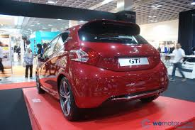 peugeot 208 red peugeot 208 gti on display at nst auto show 2013 wemotor com