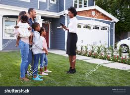 real estate agent showing family house stock photo 401695168